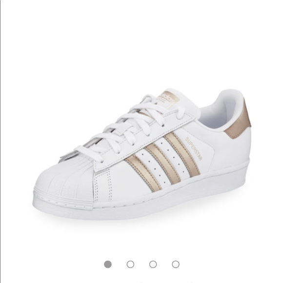 White and gold striped adidas superstars